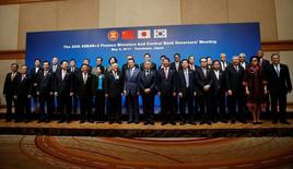 Finance ministers and central bank governors pose during a photo session at ASEAN+3 Finance Ministers and Central Bank Governors' Meeting on the sideline of Asian Development Bank (ADB)'s annual meeting in Yokohama, south of Tokyo, Japan May 5, 2017. REUTERS/Issei Kato