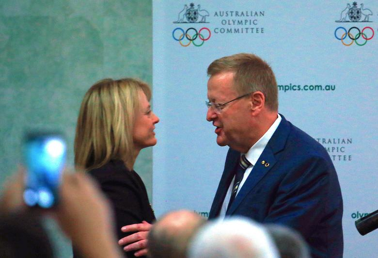 International Olympic Committee (IOC) Vice President and Australian Olympic Committee (AOC) President John Coates is congratulated by Danni Roche after he was re-elected as AOC President in a ballot at the body's annual general meeting in Sydney, Australia, May 6, 2017.     REUTERS/David Gray
