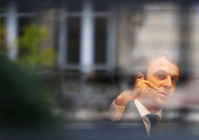 Emmanuel Macron, head of the political movement En Marche !, or Onwards !, and candidate for the 2017 presidential election, is pictured through a window of his hotel during a campaign visit in Rodez, France, May 5, 2017. REUTERS/Regis Duvignau   TPX IMAGES OF THE DAY