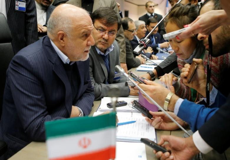 FILE PHOTO: Iran's Oil Minister Bijan Zanganeh talks to journalists during a meeting of the Organization of the Petroleum Exporting Countries (OPEC) in Vienna, Austria, November 30, 2016. REUTERS/Heinz-Peter Bader