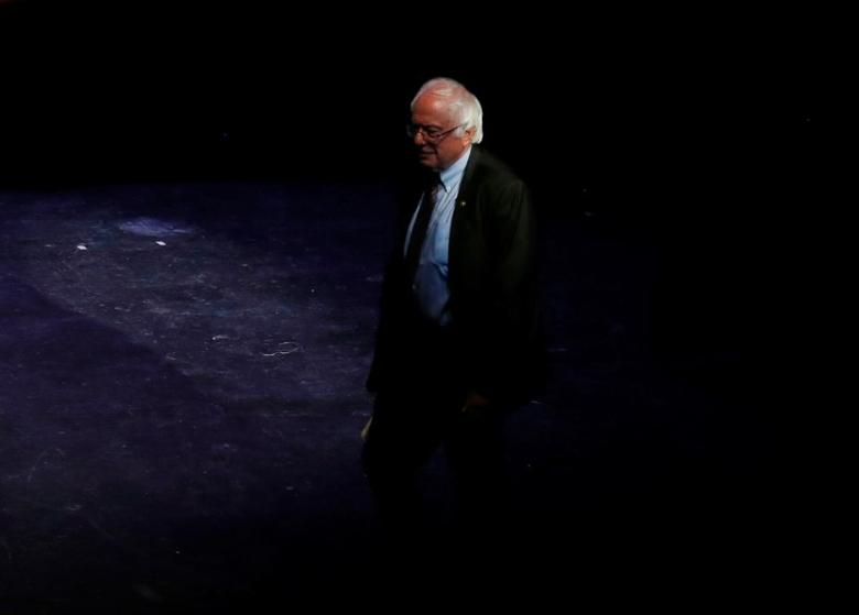 U.S. Senator Bernie Sanders (I-VT) walks onto the stage as he is introduced by U.S. Senator Elizabeth Warren (D-MA) (not pictured) at a Our Revolution rally in Boston, Massachusetts, U.S., March 31, 2017.     REUTERS/Mary Schwalm