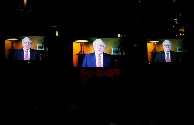 Berkshire Hathaway chairman and CEO Warren Buffett is seen speaking on giant TV screens at the start of the Berkshire Hathaway annual meeting in Omaha, Nebraska, U.S. May 6, 2017. REUTERS/Rick Wilking