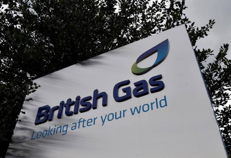 FILE PHOTO: A British Gas sign is seen outside its offices in Staines in southern England, July 31, 2014. British utility Centrica posted a 35 percent fall in operating profit for the first half of the year as a mild winter in its home market led to reduced energy demand and extreme weather in North America increased costs. REUTERS/Toby Melville