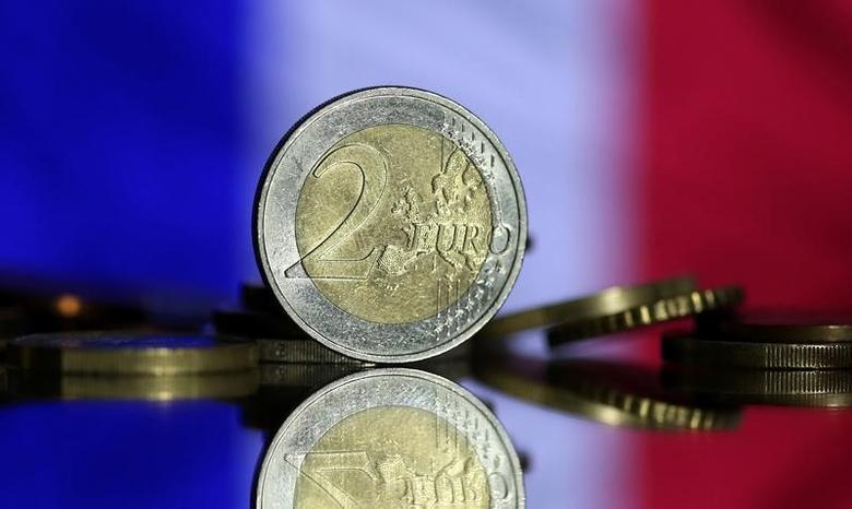 Euro coins are seen in front of displayed France flag in this picture illustration taken May 7, 2017. REUTERS/Dado Ruvic/Illustration -