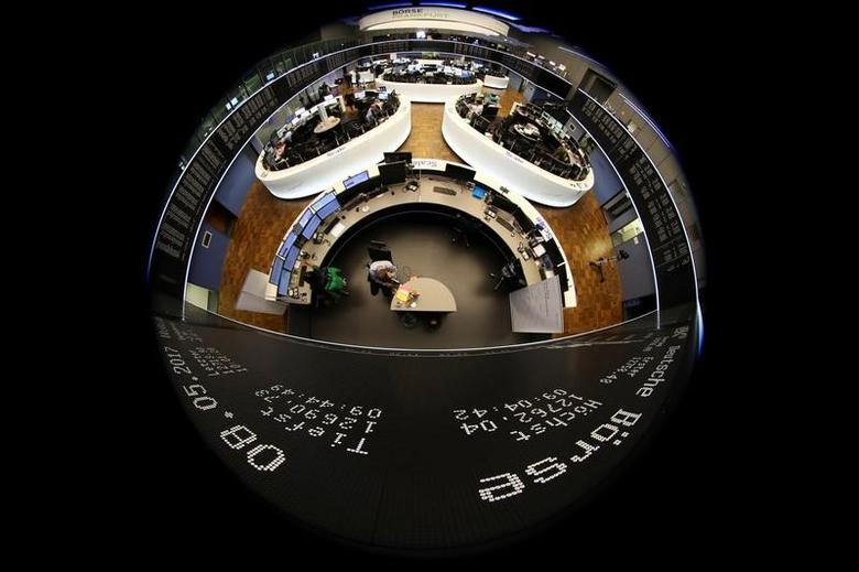 Traders work in front of the German share price index, DAX board, at the stock exchange in Frankfurt, Germany, May 8, 2017. REUTERS/Pawel Kopczynski