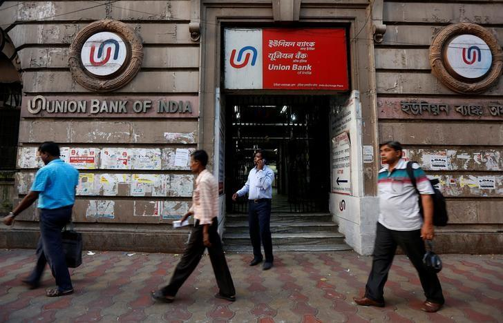 People walk past the Union Bank of India branch in Kolkata, India April 11, 2017. REUTERS/Rupak De Chowdhuri/Files