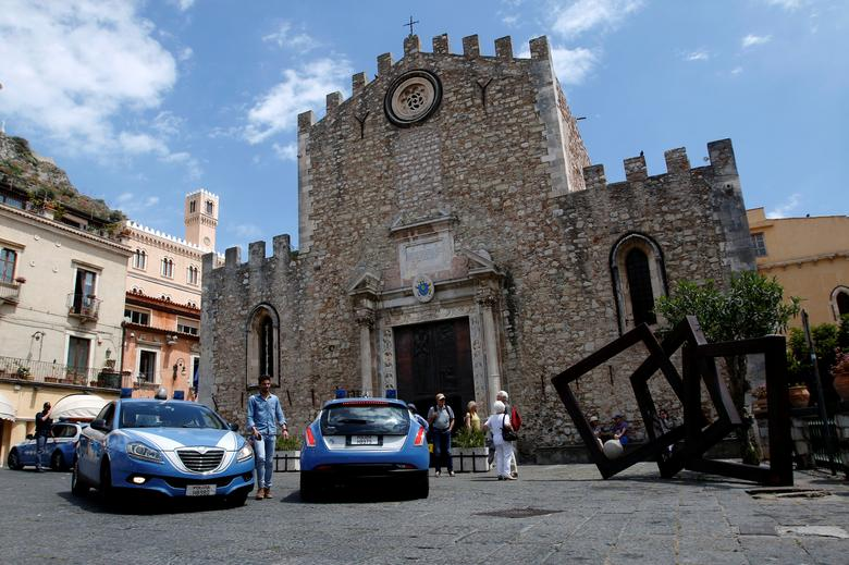 Italian Police patrol in front of a church in the Sicilian town, where leaders from the world's major Western powers will hold their annual summit in Taormina Italy May 2, 2017. REUTERS/Antonio Parrinello