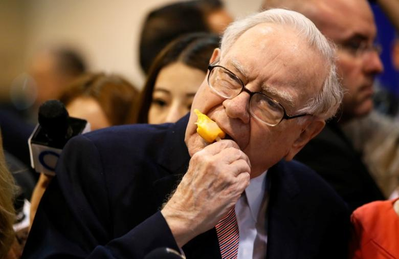 Berkshire Hathaway chairman and CEO Warren Buffett enjoys an ice cream treat from Dairy Queen before the Berkshire Hathaway annual meeting in Omaha, Nebraska. REUTERS/Rick Wilking