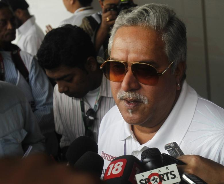 FILE PHOTO: Force India team principal Vijay Mallya talks to the media in the paddock during the third practice session of the Indian F1 Grand Prix at the Buddh International Circuit in Greater Noida, on the outskirts of New Delhi, October 27, 2012. REUTERS/Ahmad Masood