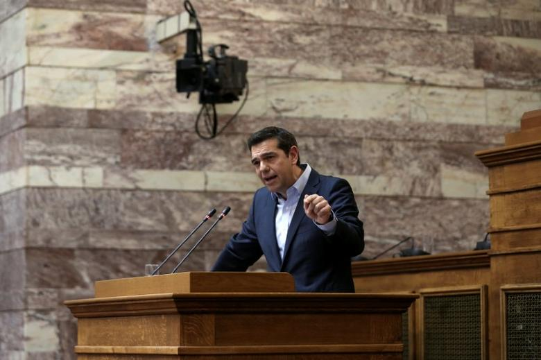 FILE PHOTO: Greek Prime Minister Alexis Tsipras addresses his lawmakers during a session of the ruling Syriza party parliamentary group at the parliament in Athens, Greece May 5, 2017. REUTERS/Alkis Konstantinidis