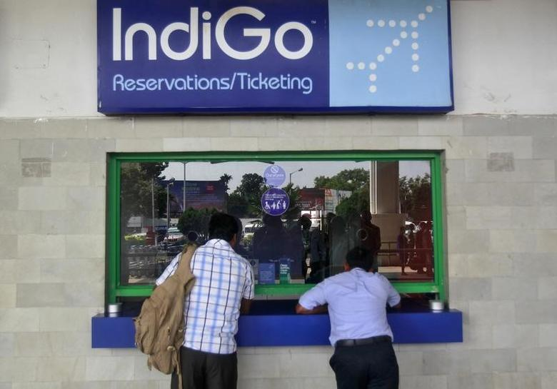 Passengers stand at the ticket counter of Indigo Airlines at the airport on the outskirts of Agartala, capital of India's northeastern state of Tripura, October 16, 2014.  REUTERS/Jayanta Dey