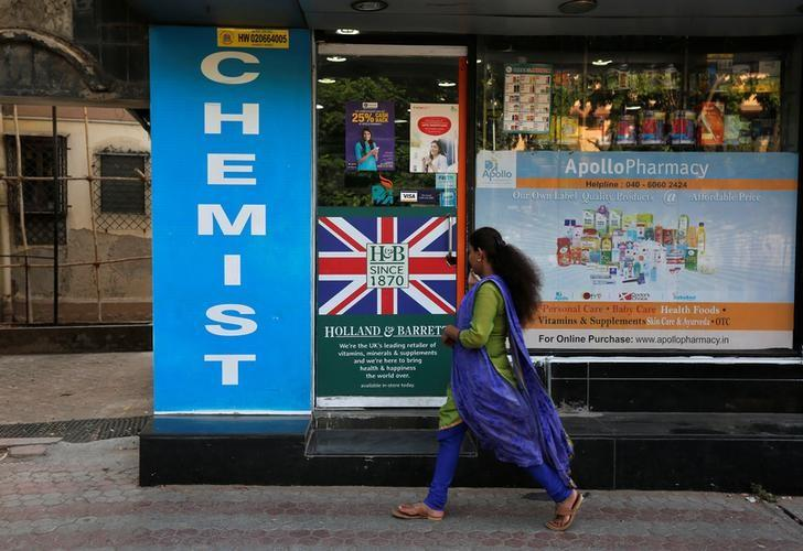 A woman walks past a chemist shop in Mumbai, April 28, 2017. REUTERS/Shailesh Andrade/Files