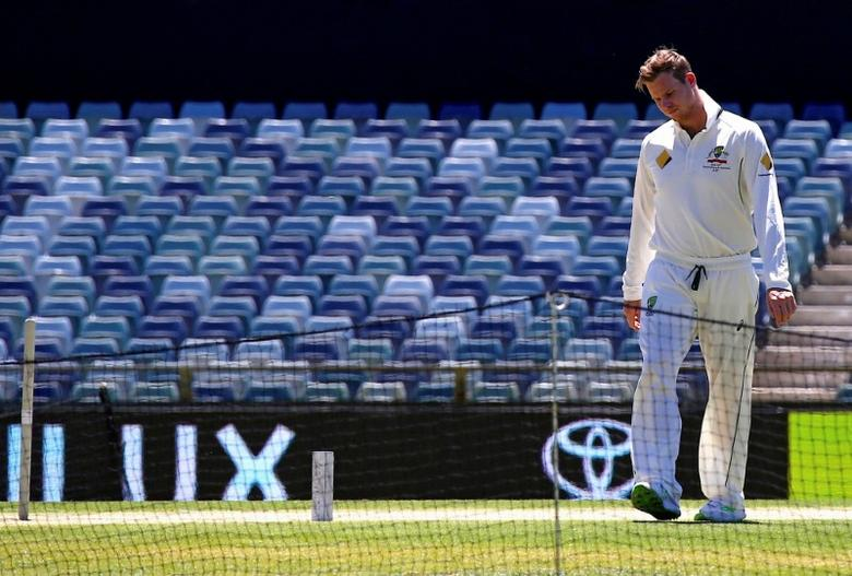 FILE PHOTO: Australian cricket team captain Steve Smith inspects the pitch after a training session at the WACA Ground in Perth, Australia, November 2, 2016.       REUTERS/David Gray