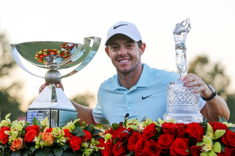 FILE PHOTO: Sep 25, 2016; Atlanta, GA, USA; Rory McIlroy celebrates with the FedEx Cup Trophy and the Tour Championship Trophy after the final playoff round of the Tour Championship at East Lake Golf Club. Butch Dill-USA TODAY Sports