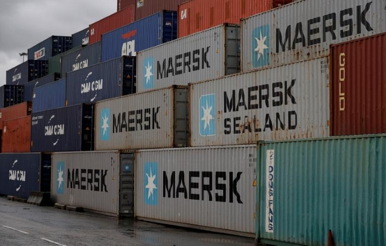 FILE PHOTO: Empty Maersk shipping containers are seen stacked at Peel Ports container terminal in Liverpool northern England, December 9, 2016. REUTERS/Phil Noble/File Photo