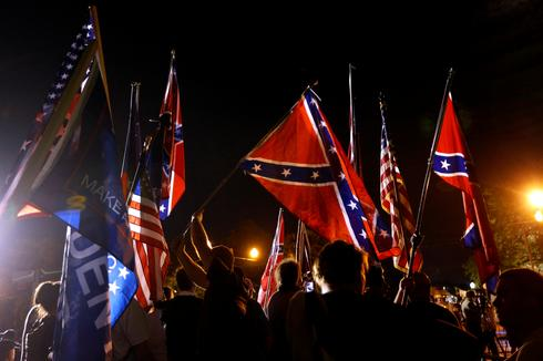 Protest as Confederate statue removed