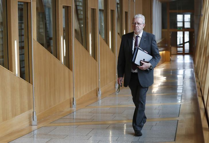 Michael Russell arrives to attend a debate on a second referendum on independence at Scotland's Parliament in Holyrood, Edinburgh, Britain, March 28, 2017. REUTERS/Russell Cheyne/Files