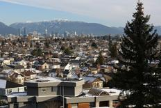 FILE PHOTO: Rooftops of houses in the Kitsilano neighbourhood and the downtown core are seen in Vancouver, British Columbia, Canada January 7, 2017.  REUTERS/Chris Helgren