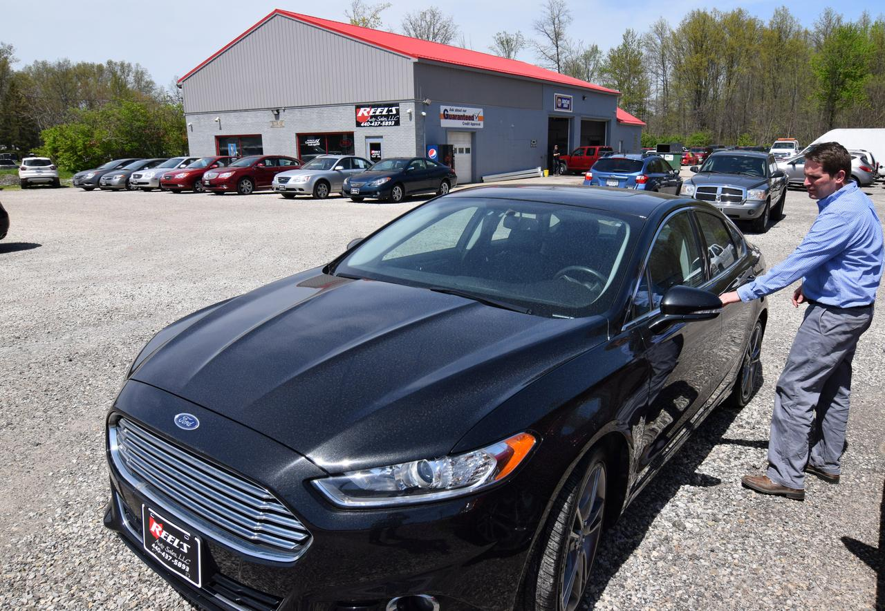 dan reel shows one of his off lease vehicles on the lot at reels auto a used car dealership in orwell ohio us april 26 2017 photo taken april 26
