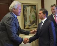 Mexico's President Enrique Pena Nieto shakes hands with Jeffrey R. Immelt, Chief Executive of General Electric at Los Pinos presidential residence in Mexico City, in this undated handout photo released to Reuters by the Mexican Presidency on May 12, 2017. Mexico Presidency/Handout via REUTERS