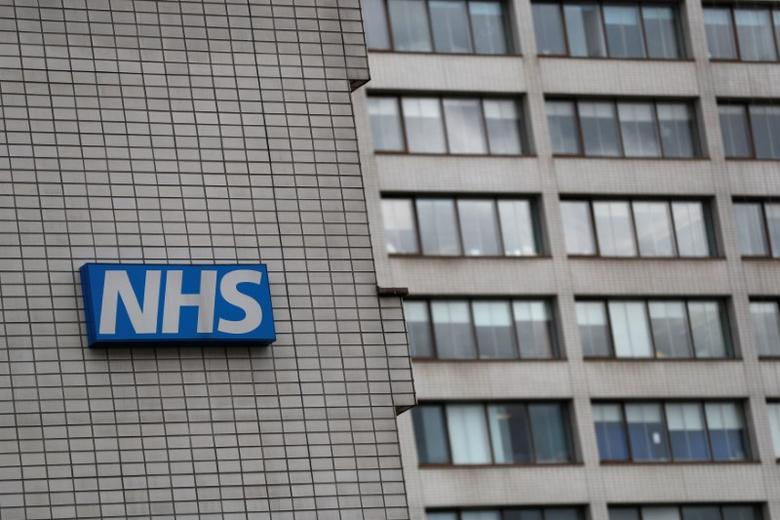 An NHS sign is seen at St Thomas' Hospital in central London, Britain May 12, 2017. REUTERS/Stefan Wermuth