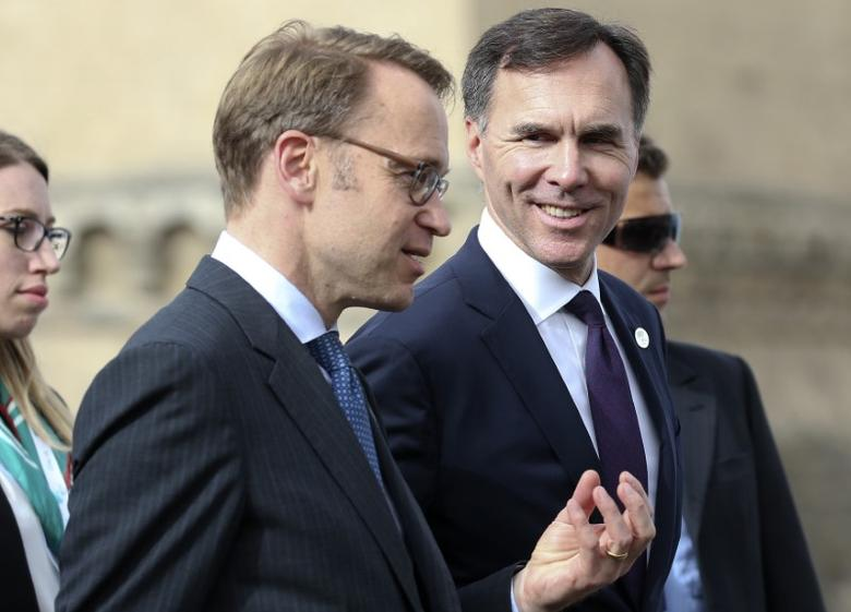 Canada's Finance Minister Bill Morneau (R) speaks with Bundesbank President Jens Weidmann during the G7 for Financial ministers meeting in the southern Italian city of Bari, Italy May 12, 2017. REUTERS/Alessandro Bianchi