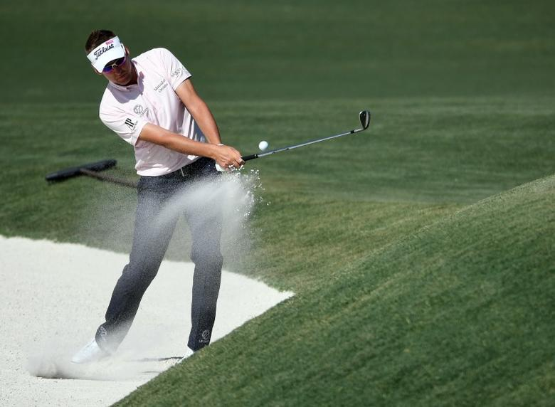 May 14, 2017; Ponte Vedra Beach, FL, USA;   Ian Poulter blasts out of the sand onto the 11th green during the final round of The Players Championship golf tournament at TPC Sawgrass - Stadium Course. Michael Madrid-USA TODAY Sports