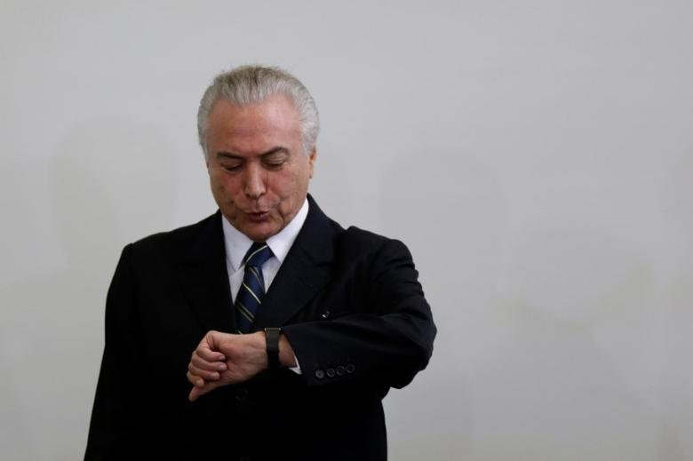 Brazil's President Michel Temer, gestures during a meeting with ministers and congressmen for evaluating a year of government, at the Planalto Palace in Brasilia, Brazil May 12, 2017. REUTERS/Ueslei Marcelino