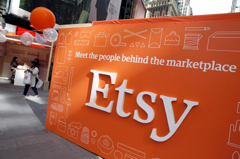 A sign advertising the online seller Etsy Inc. is seen outside the Nasdaq market site in Times Square following Etsy's initial public offering (IPO) on the Nasdaq in New York April 16, 2015.   REUTERS/Mike Segar/File Photo
