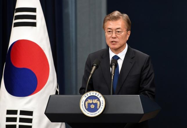 FILE PHOTO: South Korea's new President Moon Jae-In speaks during a press conference at the presidential Blue House in Seoul on May 10, 2017. REUTERS/Jung Yeon-Je/Pool
