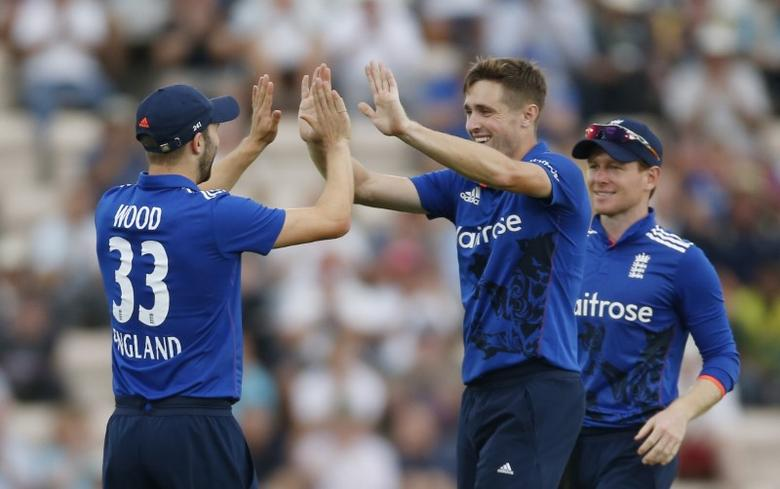 Cricket Britain - England v Pakistan - First One Day International - The Ageas Bowl - 24/8/16 England's Chris Woakes and Mark Wood celebrate after taking the wicket of Pakistan's Sarfraz Ahmed Action Images via Reuters / Paul Childs Livepic