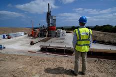 FILE PHOTO: An employee poses for a photograph at the Sirius Minerals test drilling station on the North Yorkshire Moors near Whitby, Britain, July 5, 2013. REUTERS/Nigel Roddis/File Photo