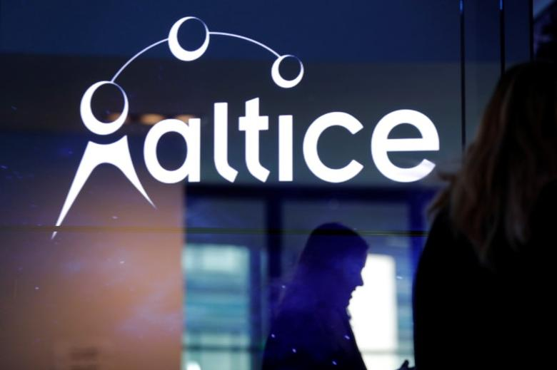 FILE PHOTO: The logo of cable and mobile telecoms company Altice Group is seen during a news conference in Paris, France, March 21, 2017. REUTERS/Philippe Wojazer/File Photo