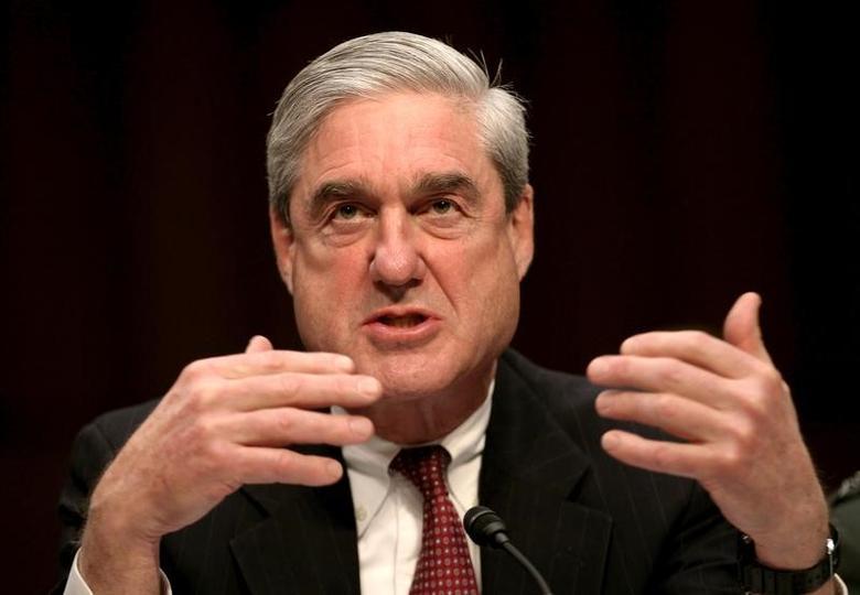 FILE PHOTO - FBI Director Robert Mueller testifies at a Senate Intelligence Committee hearing on Capitol Hill in Washington, DC, U.S. on February 16, 2011.   REUTERS/Jason Reed/File Photo