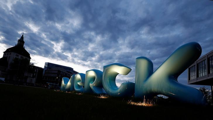 The logo of German pharmaceuticals company Merck is seen in front of the company's headquarters in Darmstadt, Germany, May 16, 2016.  REUTERS/Kai Pfaffenbach/File Photo               GLOBAL BUSINESS WEEK AHEAD PACKAGE - SEARCH 'BUSINESS WEEK AHEAD 24 OCT'  FOR ALL IMAGES