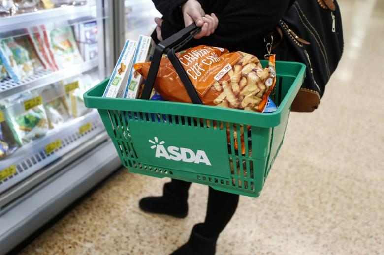 FILE PHOTO: A shopper browses produce at the Asda superstore in High Wycombe, Britain, February 8, 2017.  REUTERS/Eddie Keogh/File Photo