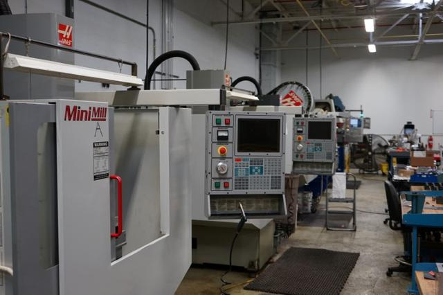 These computer-controlled cutting machines at Gem Tool, which were bought used by the company, owned by Dan T. Moore Company, specializes in machining high-precision parts for other manufacturers, in Cleveland, Ohio, U.S. shown in this image released on May 17, 2017.   Courtesy Dan T. Moore Company/Handout via REUTERS