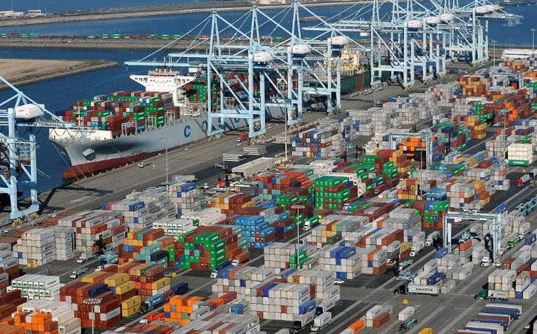 FILE PHOTO: Shipping containers sit at the ports of Los Angeles and Long Beach, California, U.S. on February 6, 2015.  REUTERS/Bob Riha, Jr./File Photo