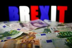 FILE PHOTO: Euro and Pound banknotes are seen in front of BREXIT letters in this picture illustration taken April 28, 2017. REUTERS/Dado Ruvic/Illustration/File Photo