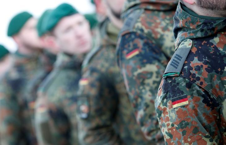 Soldiers of the German armed forces Bundeswehr take part in farewell ceremony for mechanized infantry Panzergrenadierbataillon 122, to be deployed in Lithuania, in Oberviechtach, Germany January 19, 2017.  REUTERS/Michaela Rehle