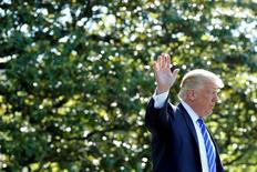 FILE PHOTO: U.S. President Donald Trump waves as he walks on the South Lawn of the White House in Washington, U.S., before his departure to Groton, Connecticut, May 17, 2017. REUTERS/Yuri Gripas/File Photo