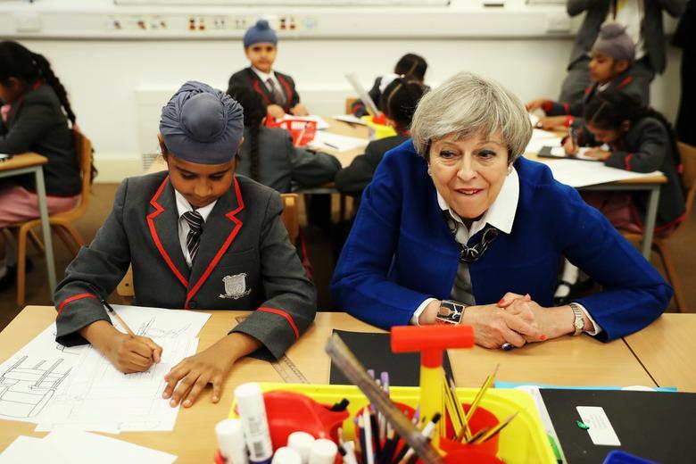 Britain's Prime Minister Theresa May meets the Nishkam Trust leadership team and pupils of Nishkam Primary School in Birmingham, May 16, 2017. REUTERS/ Dan Kitwood/Pool
