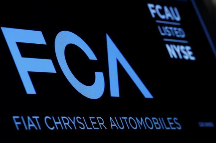 A screen displays the ticker information for Fiat Chrysler Automobiles NV at the post where it's traded on the floor of the New York Stock Exchange (NYSE) in New York City, U.S., January 12, 2016. REUTERS/Brendan McDermid/Files