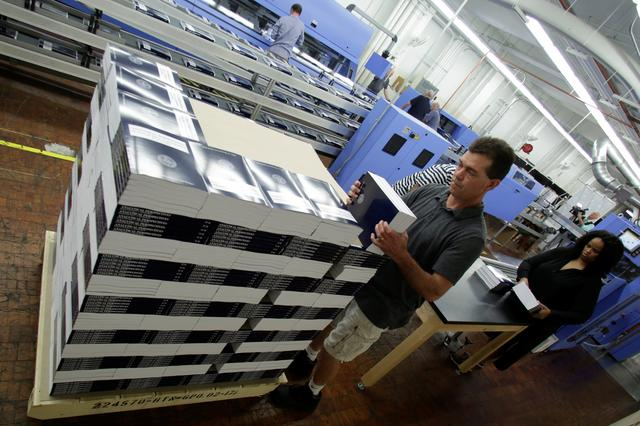 Workers prepare for delivery printed President Donald Trump's FY2018 budget at the Government Publishing Office in Washington, U.S., May 19, 2017. REUTERS/Yuri Gripas