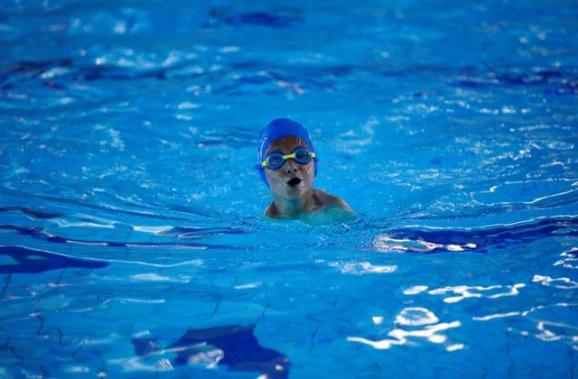 Ismail Zulfic, 6-year old armless swimmer swims in Olympic Pool Otoka in Sarajevo, May 18, 2017. Picture taken May 18, 2017. REUTERS/Dado Ruvic