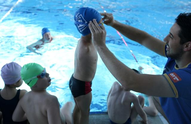 Ismail Zulfic, 6-year old armless swimmer prepares his goggles before swimming in Olympic Pool Otoka in Sarajevo, May 18, 2017. Picture taken May 18, 2017. REUTERS/Dado Ruvic