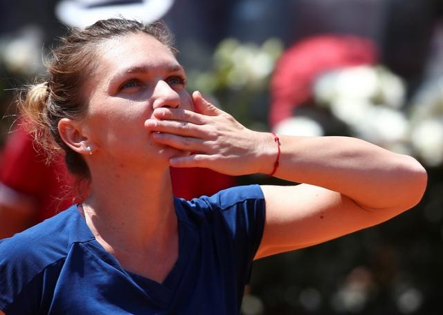 Tennis - WTA - Rome Open - Simona Halep of Romania v Anett Kontaveit of Estonia - Rome, Italy - 19/5/17 - Halep celebrates after winning a match. REUTERS/Alessandro Bianchi