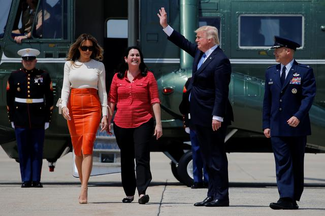 U.S. President Donald Trump (2nd R) and his wife Melania arrive to board Air Force One for his first international trip as president, including stops in Saudi Arabia, Israel, the Vatican, Brussels and at the G7 summit in Sicily, from Joint Base Andrews, Maryland, U.S., May 19, 2017. REUTERS/Jonathan Ernst