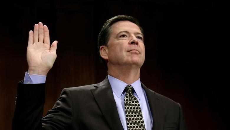 FILE PHOTO: James Comey is sworn in to testify before a Senate Judiciary Committee hearing on ''Oversight of the Federal Bureau of Investigation'' on Capitol Hill in Washington, U.S., May 3, 2017. REUTERS/Kevin Lamarque