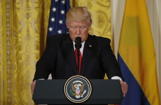 U.S. President Donald Trump listend during a joint news conference with Colombia's President Juan Manuel Santos (not pictured) at the White House in Washington, U.S. May 18, 2017. REUTERS/Kevin Lamarque